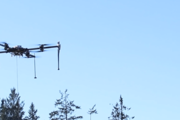 Hood Tech's VTOL operations in a forest clearing